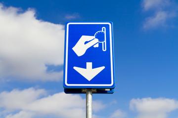 Blue parking payment sign