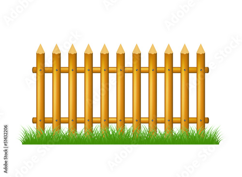Wooden fence standing in grass