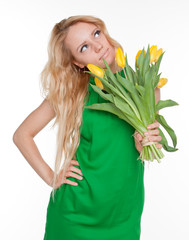 Young beautiful woman in green dress with tulips