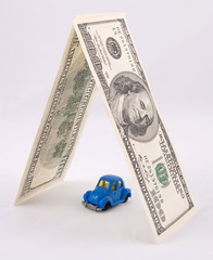 Toy retro car protected by money