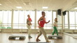 Team of women with trainer doing aerobics
