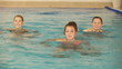 Group of healthy women doing aqua gymnastic in swimming pool