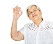Closeup of old woman gesturing okay sign. isolated