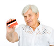 Closeup of old woman holding credit card.  isolated