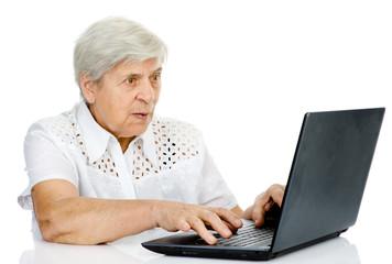 senior woman using laptop. isolated