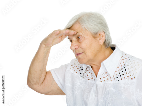 Old woman looking far, holding her arm hear her eyes. isolated