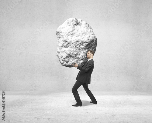 businessman holding rock