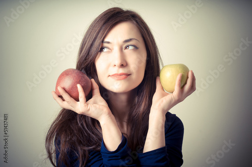 beautiful woman with red and yellow apples