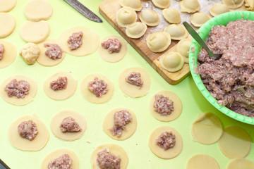 cooking meat dumplings (pelmeni)