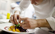canvas print picture - Chef in restaurant kitchen cooking, only hands to be se