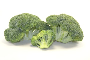 Three pieces of broccoli vegetable on white background