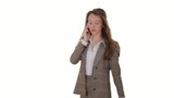 Businesswoman talking on cellphone on white background