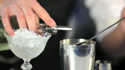 Close up footage of barman pouring liqueur in shaker