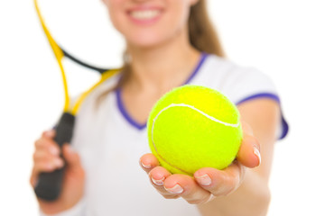 Closeup on ball in hand of female tennis player