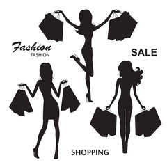 Shopping  fashionable women . Silhouettes on white background