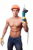 Muscular  worke with an electric drill on a white background.