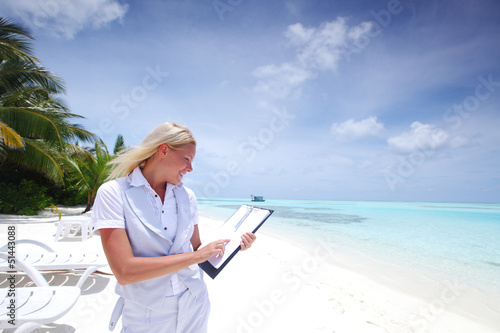 business woman with blank paper on the ocean coast