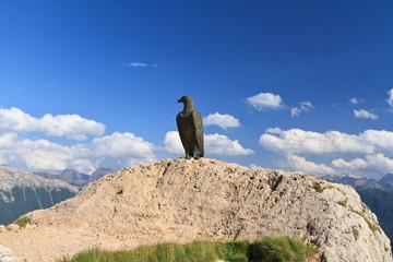 bronze eagle in Dolomites