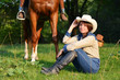 Beautiful Smiling Cowgirl with horse