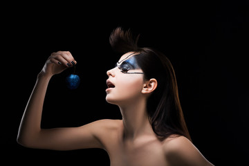 Fantasy. Fancy Woman holding a Blue Ball in hand. Inspiration