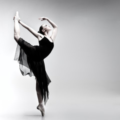 Beautiful ballet-dancer, modern style dancer posing on studio