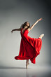 Ballet dancer wearing red dress over grey