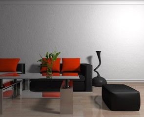 Wohndesign - Sofa schwarz vor weißer Tapete