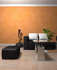 Wohndesign - Sofa schwarz vor orangener Tapete