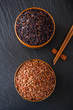 Wild rice and red rice in a bowl on a blackboard chalk