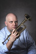 Man and his trumpet portrait