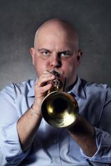 Man plays a trumpet