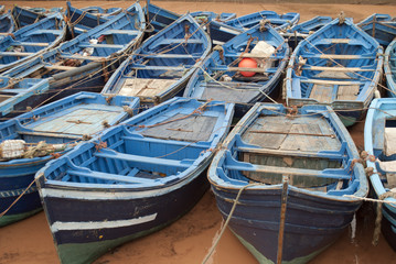 Blue fishing boats in harbor Essaouira Morocco