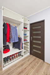 open wardrobe with clothes