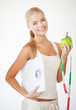 sporty woman with scale, apple and measuring tape