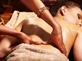 Fototapety Woman having Ayurvedic spa treatment.
