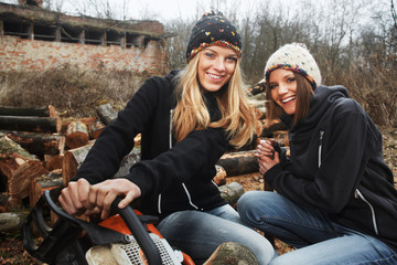two girls preparing firewood