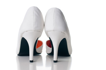 pair of white women's shoes