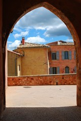 Houses behind an arc in Roussillon village, Provence, France
