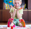 Boy with colorful  painted hands and foot