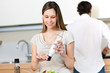 Woman preparing a salad in the kitchen