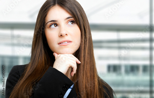 Young businesswoman thinking smiling looking up