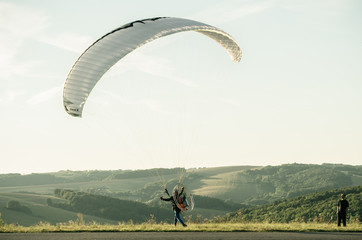 Paraglider preparing to start on a sunny day