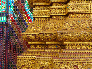 Golden engraved stucco decoration in Buddhist vihara in Thailand