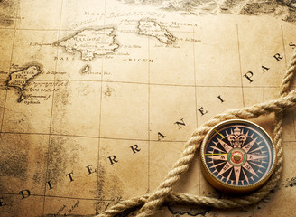 compass on vintage map 1732