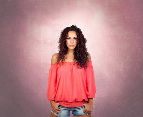 Brunette girl with a pink sensual shirt