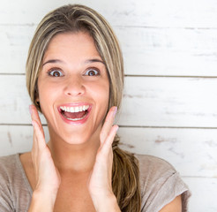 Portrait of an excited woman looking surprised