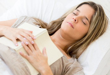 Woman falling asleep while reading