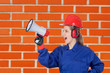 Industrial worker woman with a megaphone
