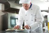 Fototapety Chef garnishing a dish