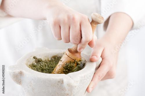 Cook preparing pesto